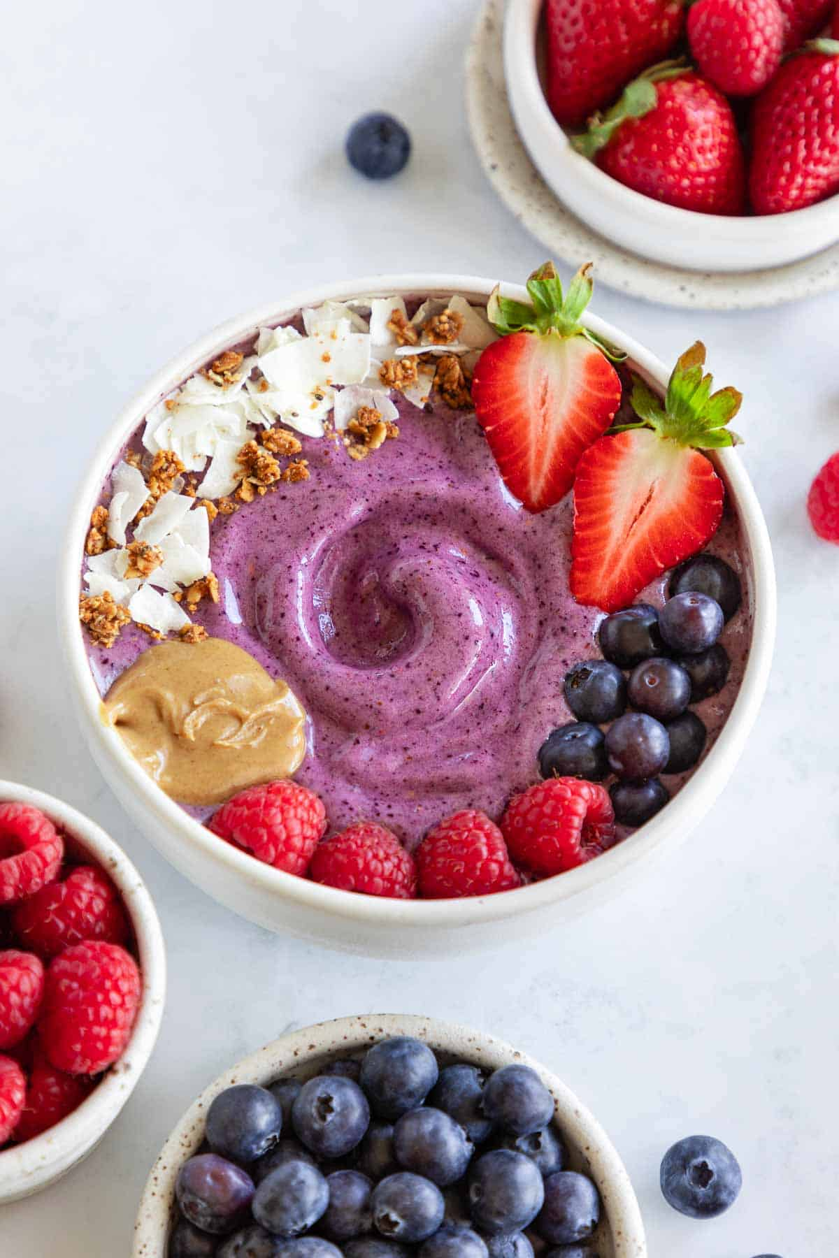 berry smoothie bowl with strawberries, blueberries, and raspberries