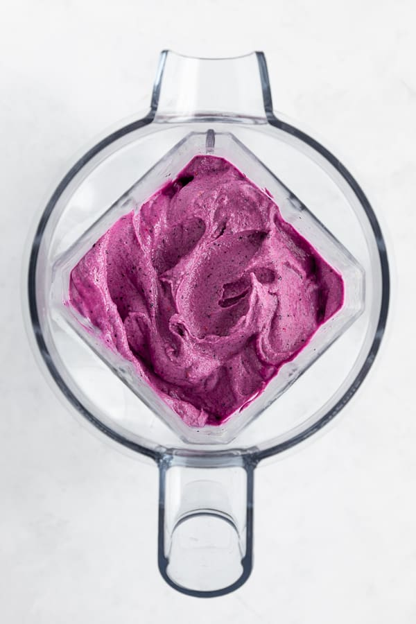 a thick and creamy berry smoothie inside a vitamix blender