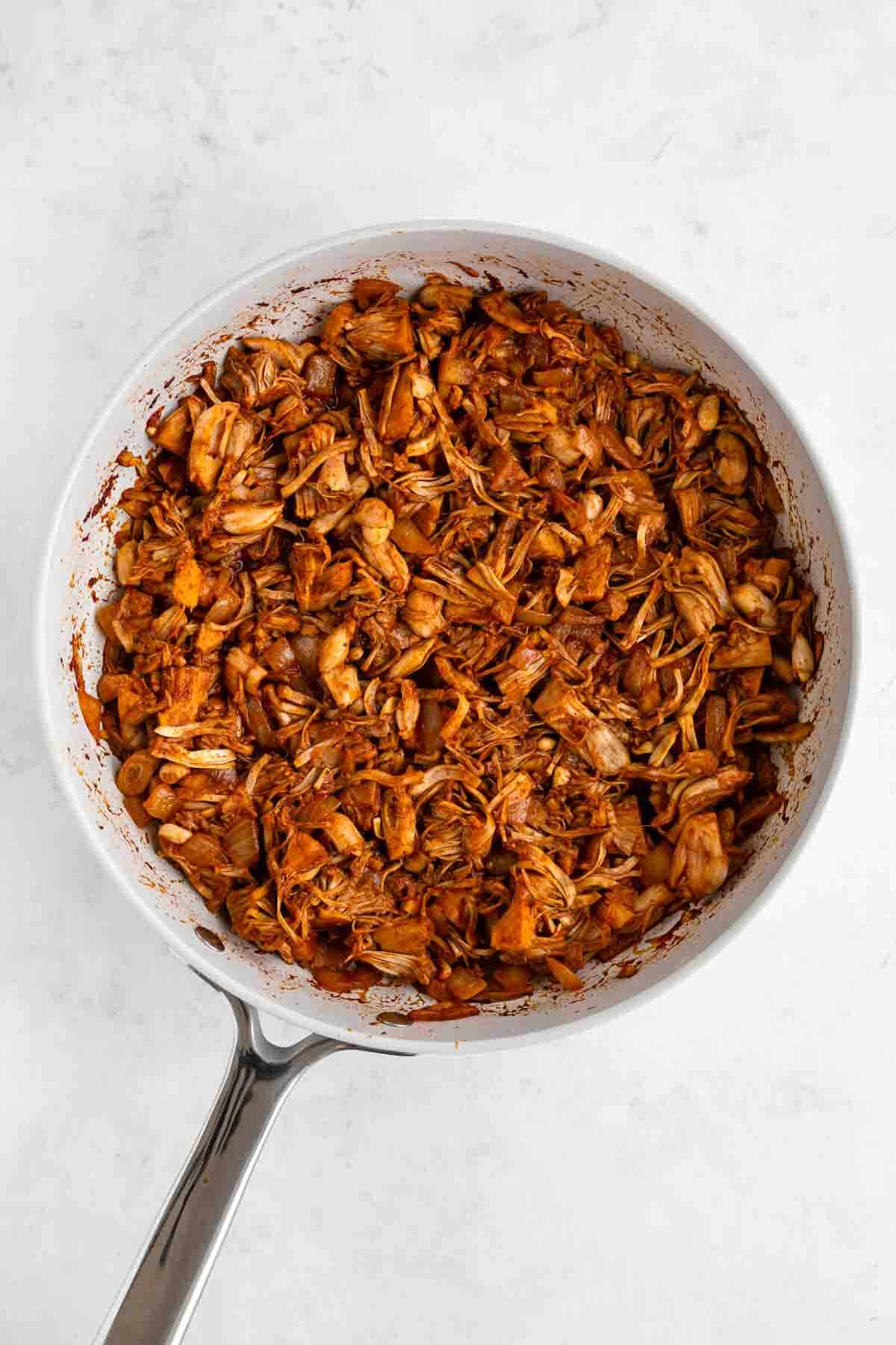 cooking spicy shredded jackfruit on a pan