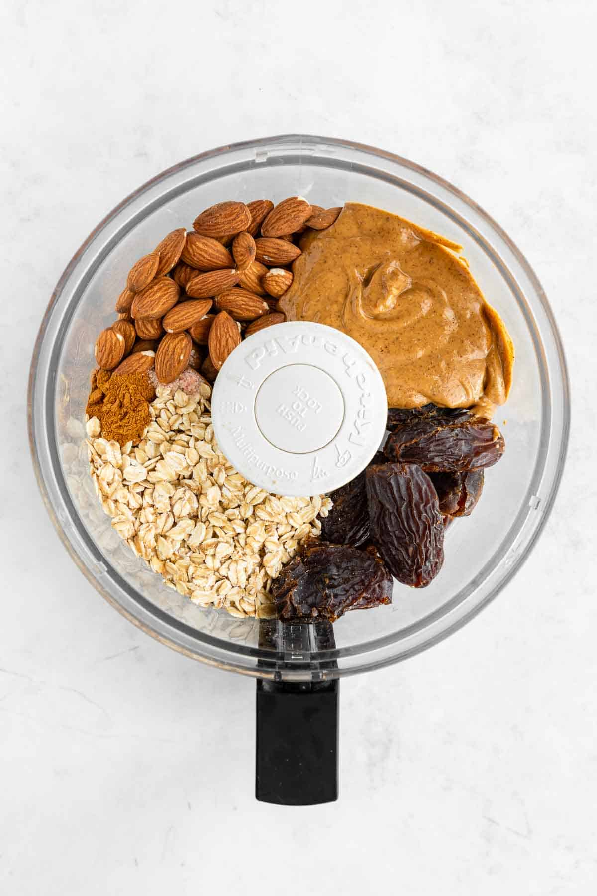 nut butter, dates, oats, and almonds in a food processor