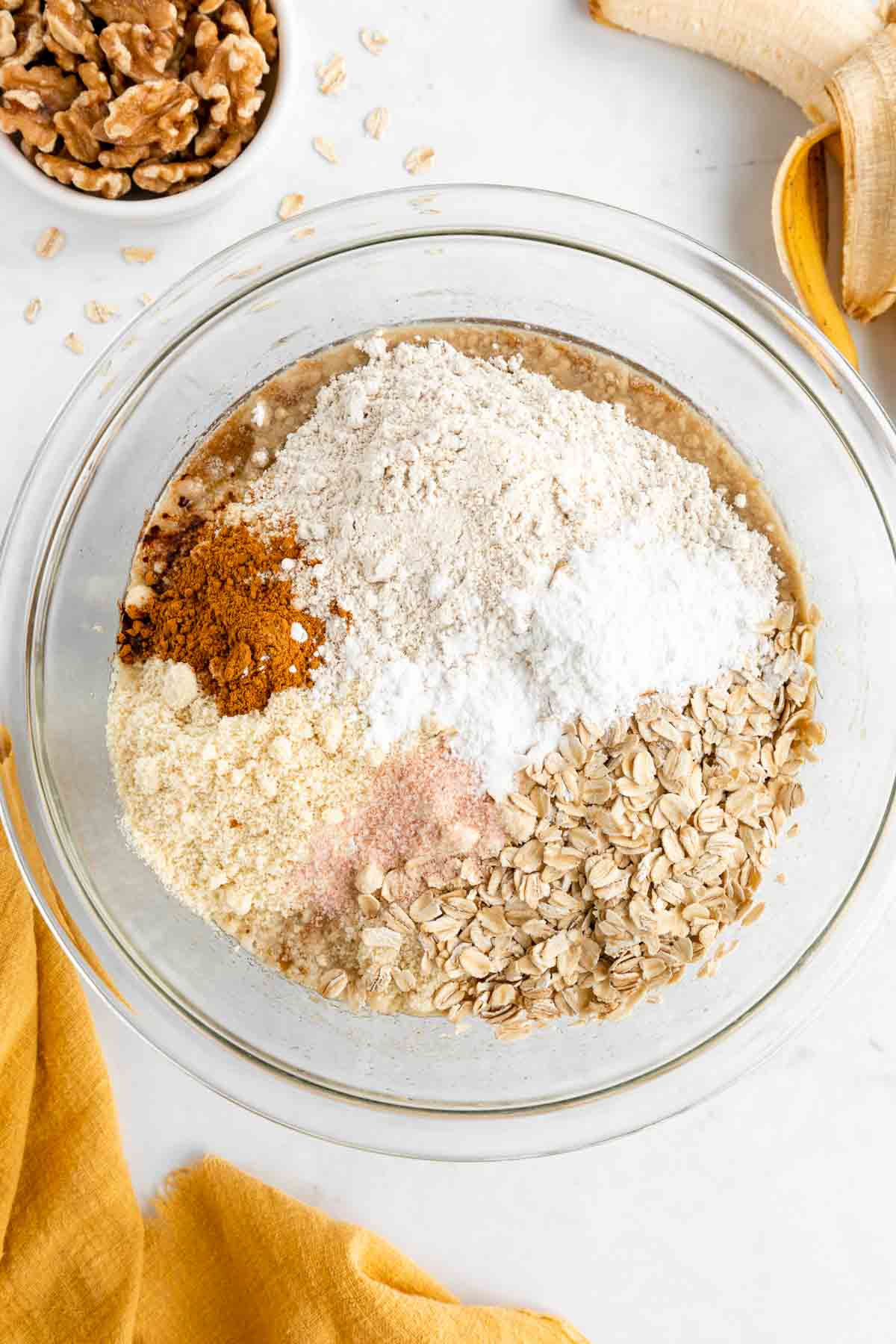 oat flour, almond flour, rolled oats, cinnamon, and salt in a mixing bowl