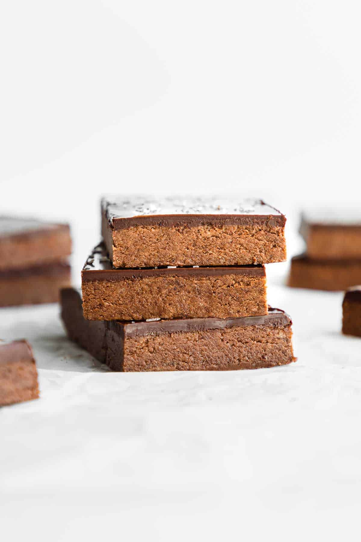 three no bake chocolate protein bars stacked on top of each other