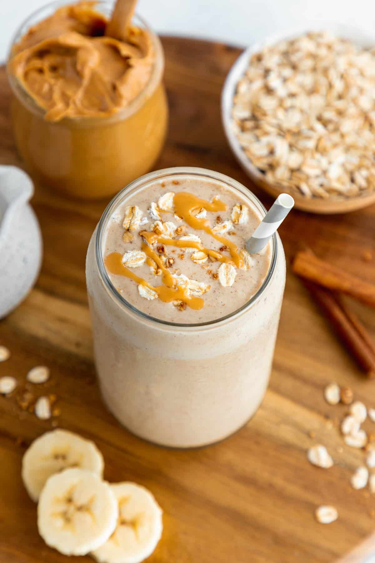 an overhead photo of an oatmeal smoothie with peanut butter
