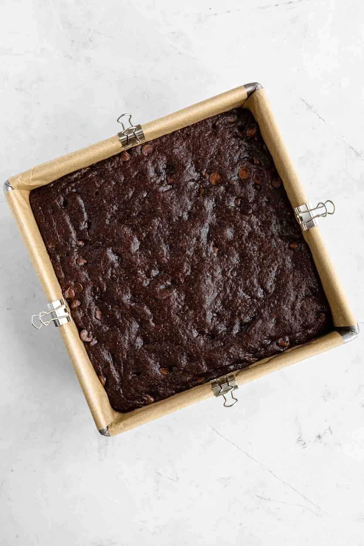 baked vegan brownies in a square baking dish