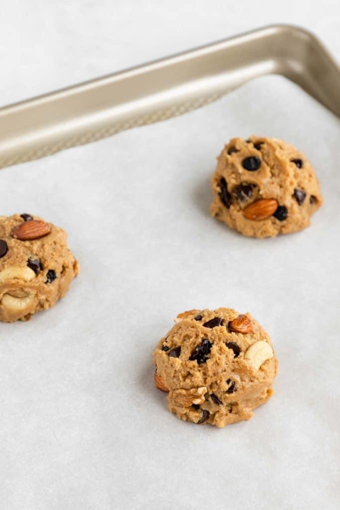 three balls of vegan trail mix cookie dough