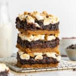 a stack of three vegan s'mores brownies on a wire cooling rack