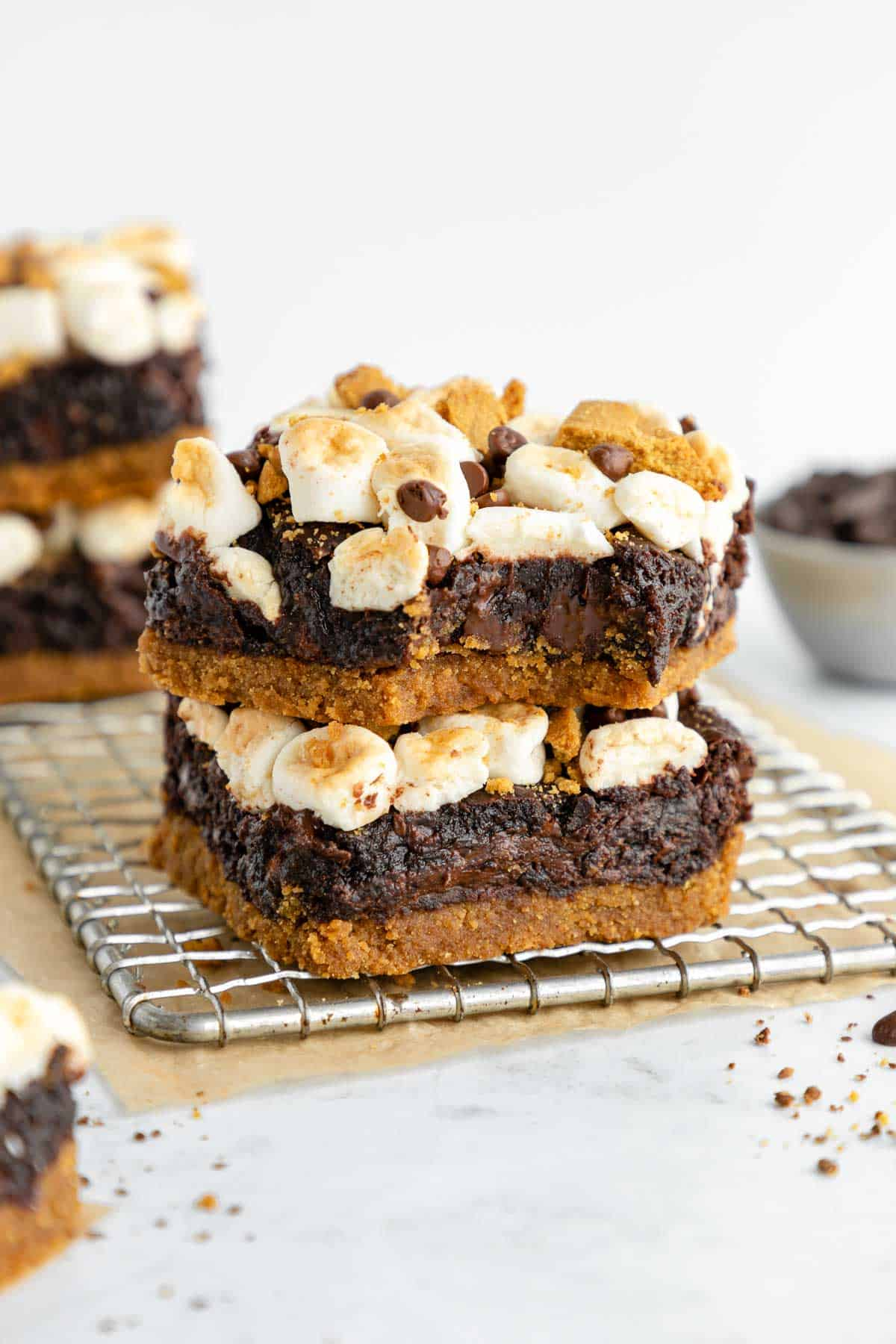 a stack of two vegan s'mores brownies on a wire cooling rack
