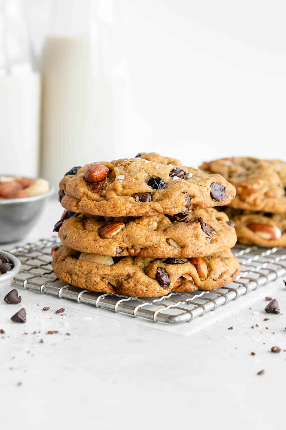 a stack of vegan trail mix cookies with chocolate chips, mixed nuts, and dried fruit