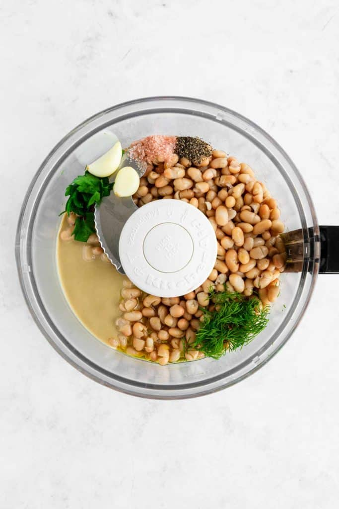 cannellini beans, tahini, olive oil, dill, garlic, parsley, and salt inside a food processor