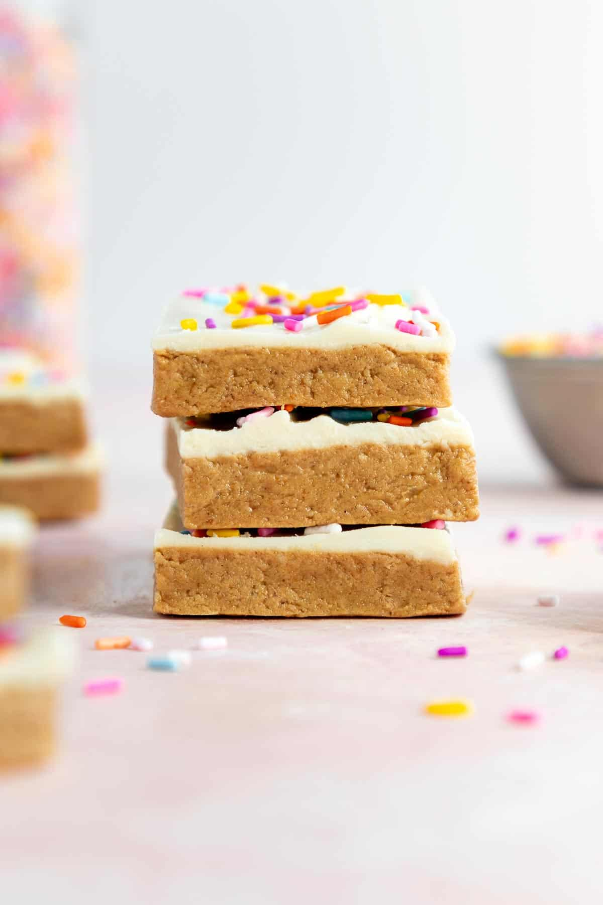 a stack of vegan birthday cake protein bars with sprinkles