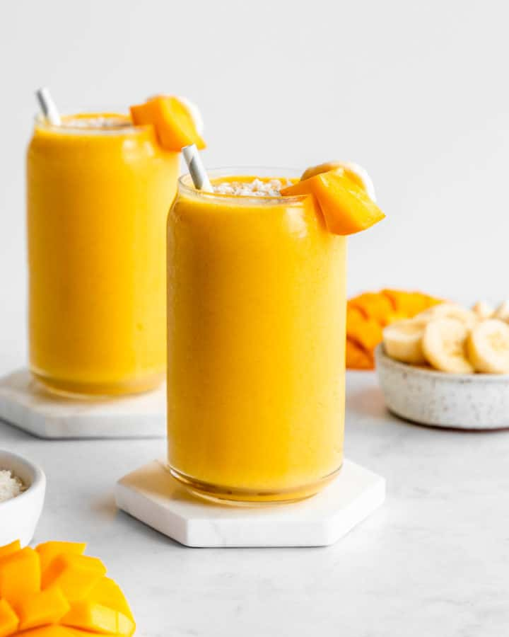 two mango banana smoothie glasses