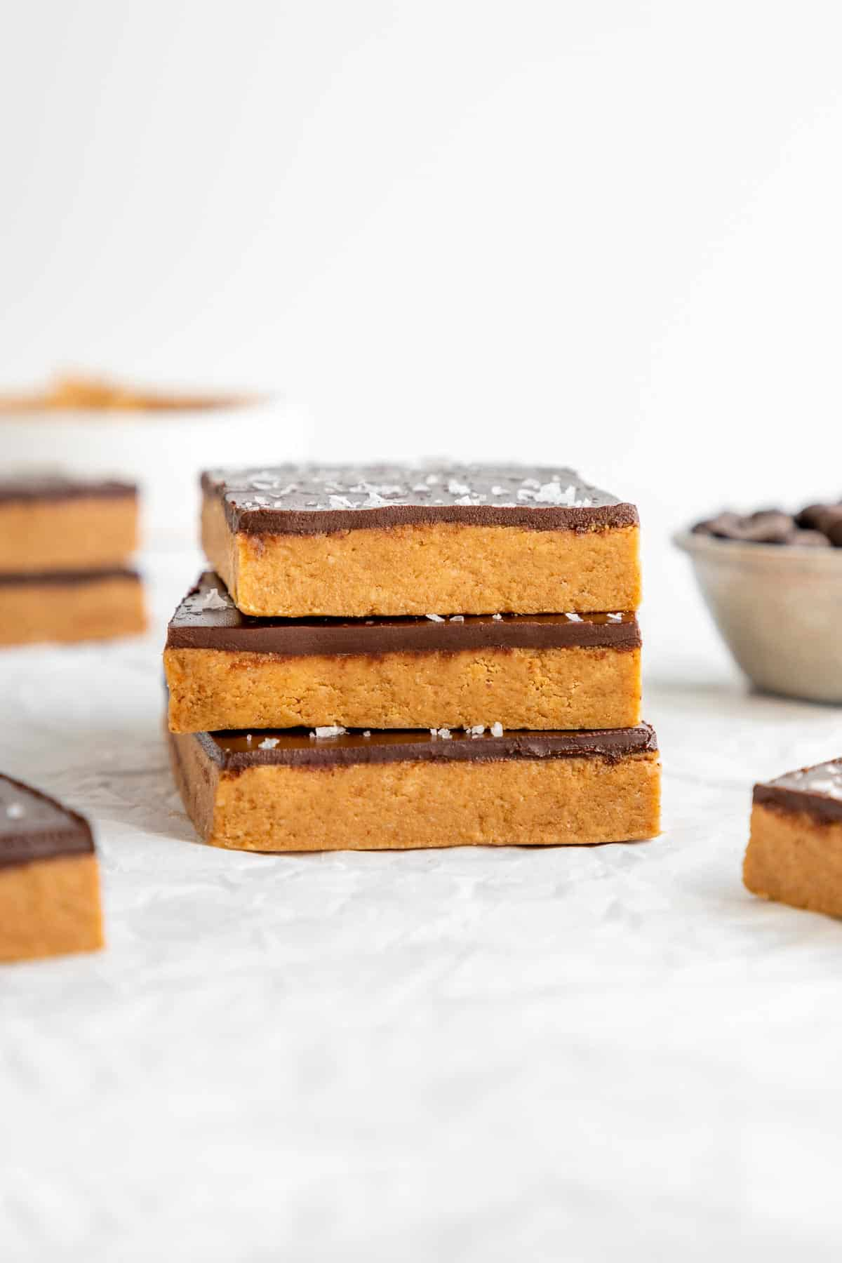 three no bake chocolate peanut butter protein bars stacked on top of each other
