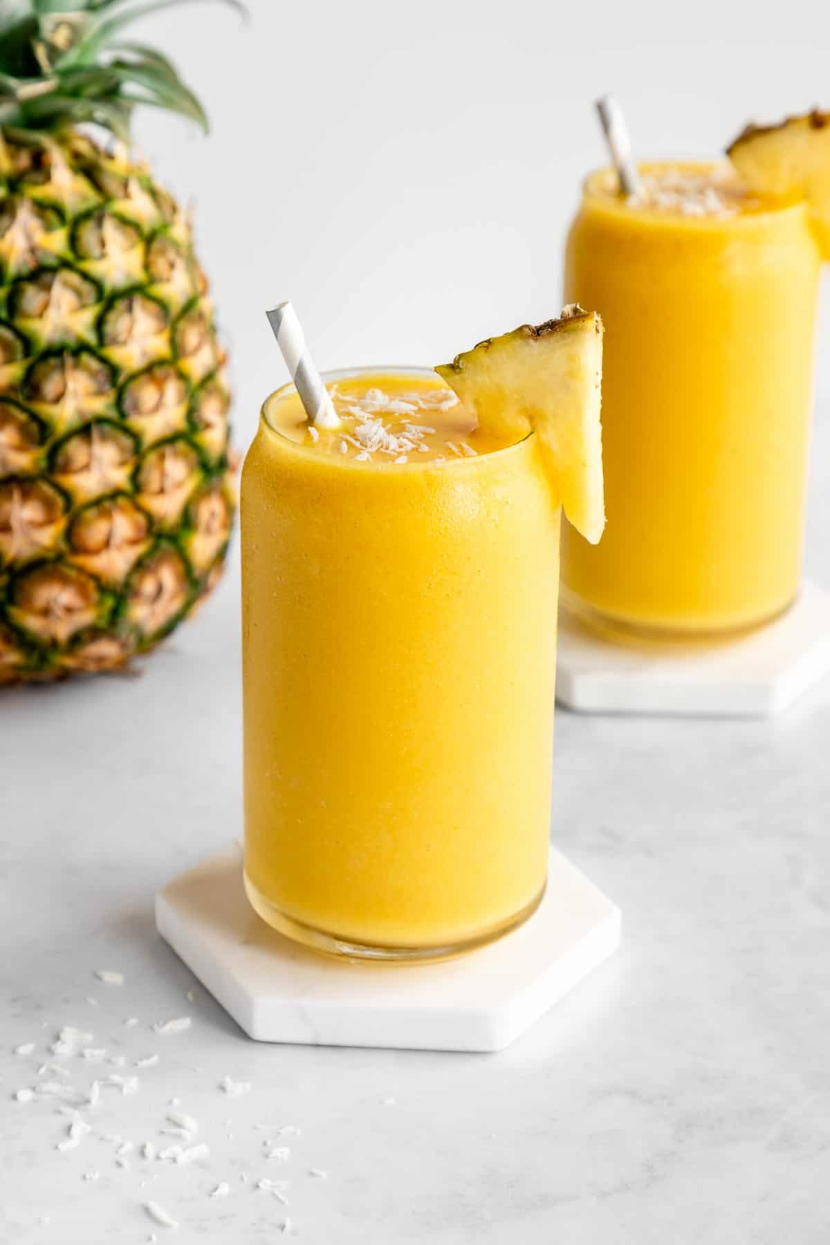 a pineapple coconut smoothie inside a glass