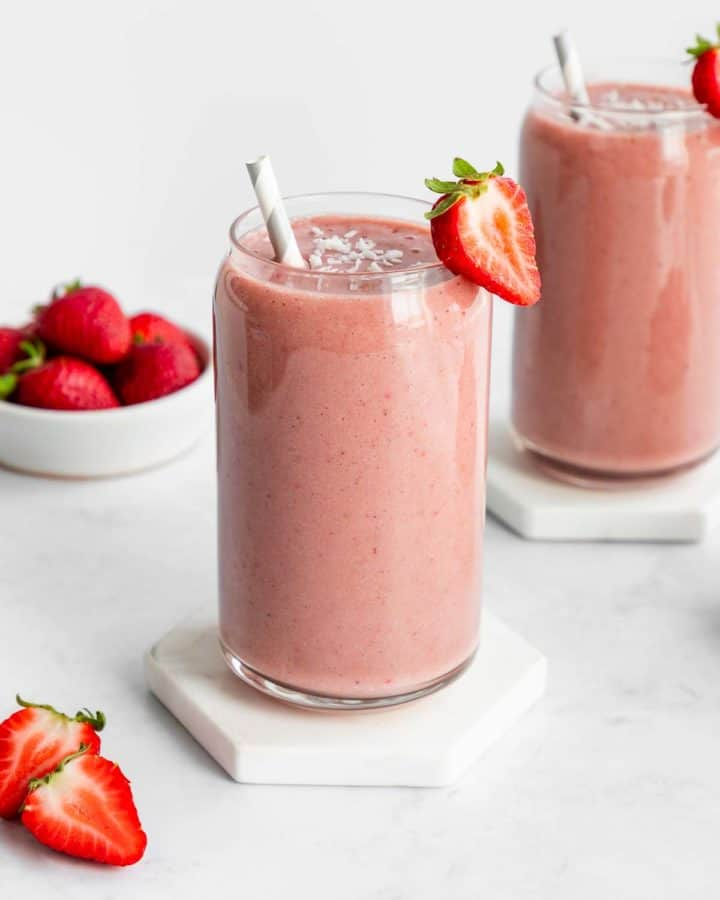 two strawberry banana smoothies inside glasses