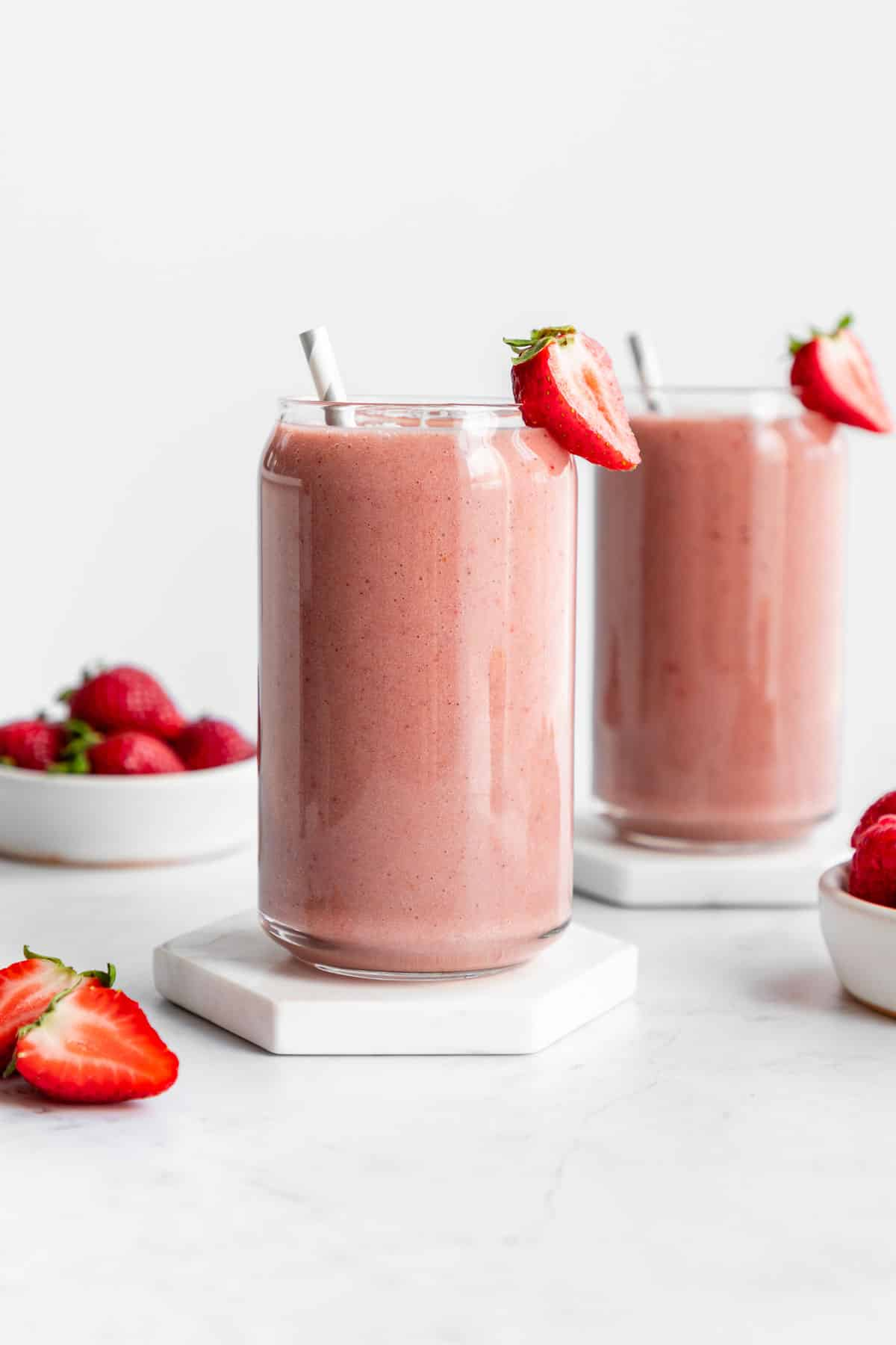 strawberry banana smoothie inside two glasses