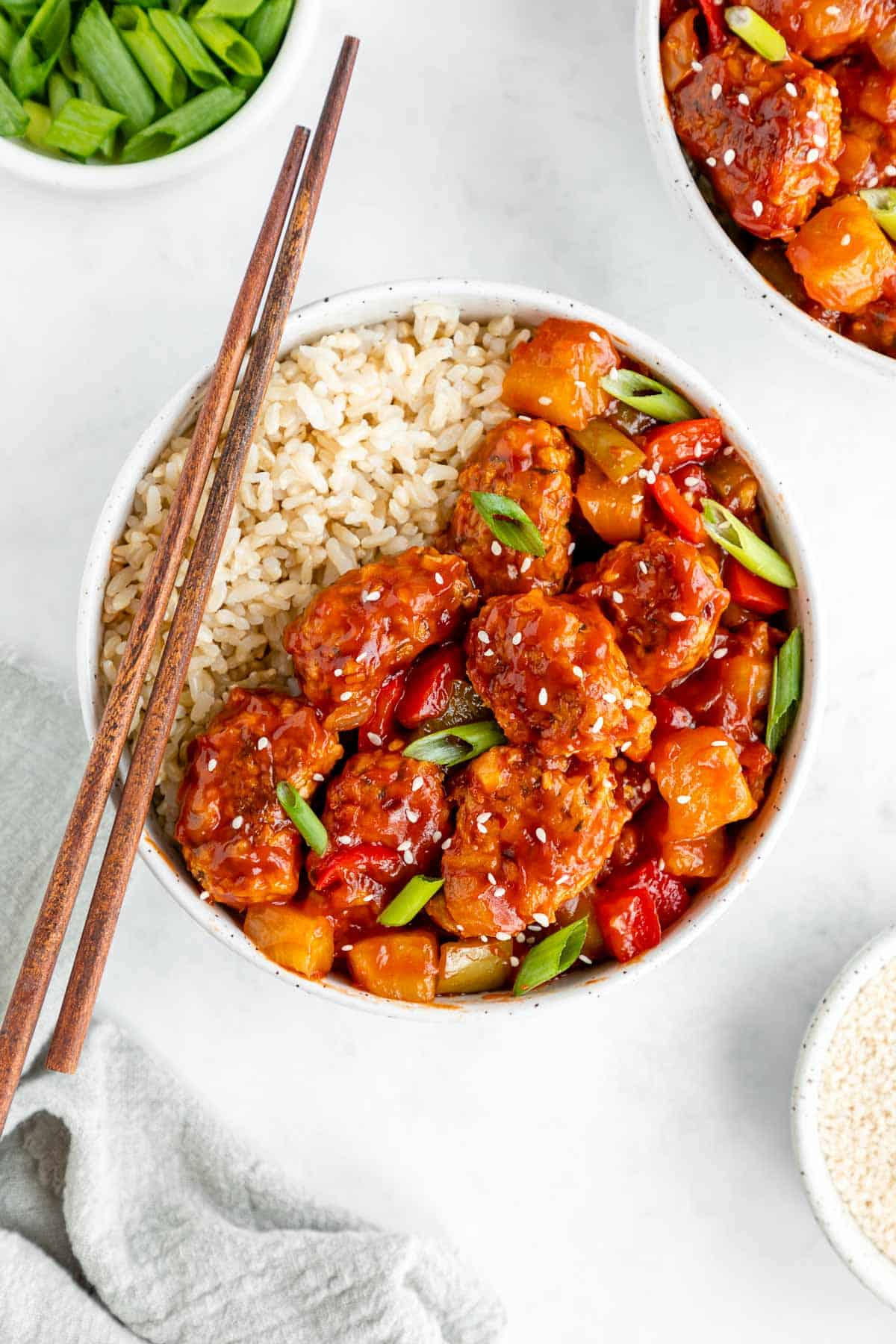 a bowl of vegan sweet and sour pork with brown rice