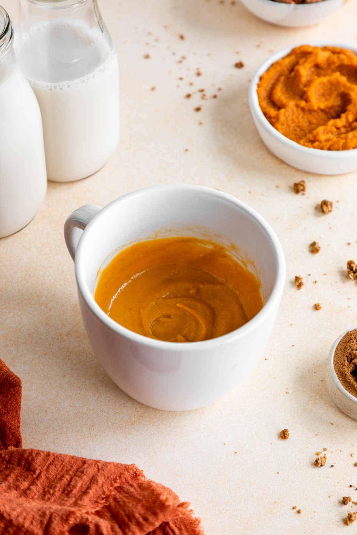 vegan pumpkin cake batter inside a mug