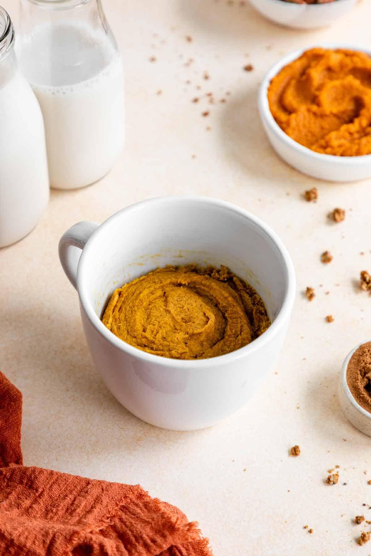 vegan gluten-free pumpkin mug cake inside a white mug