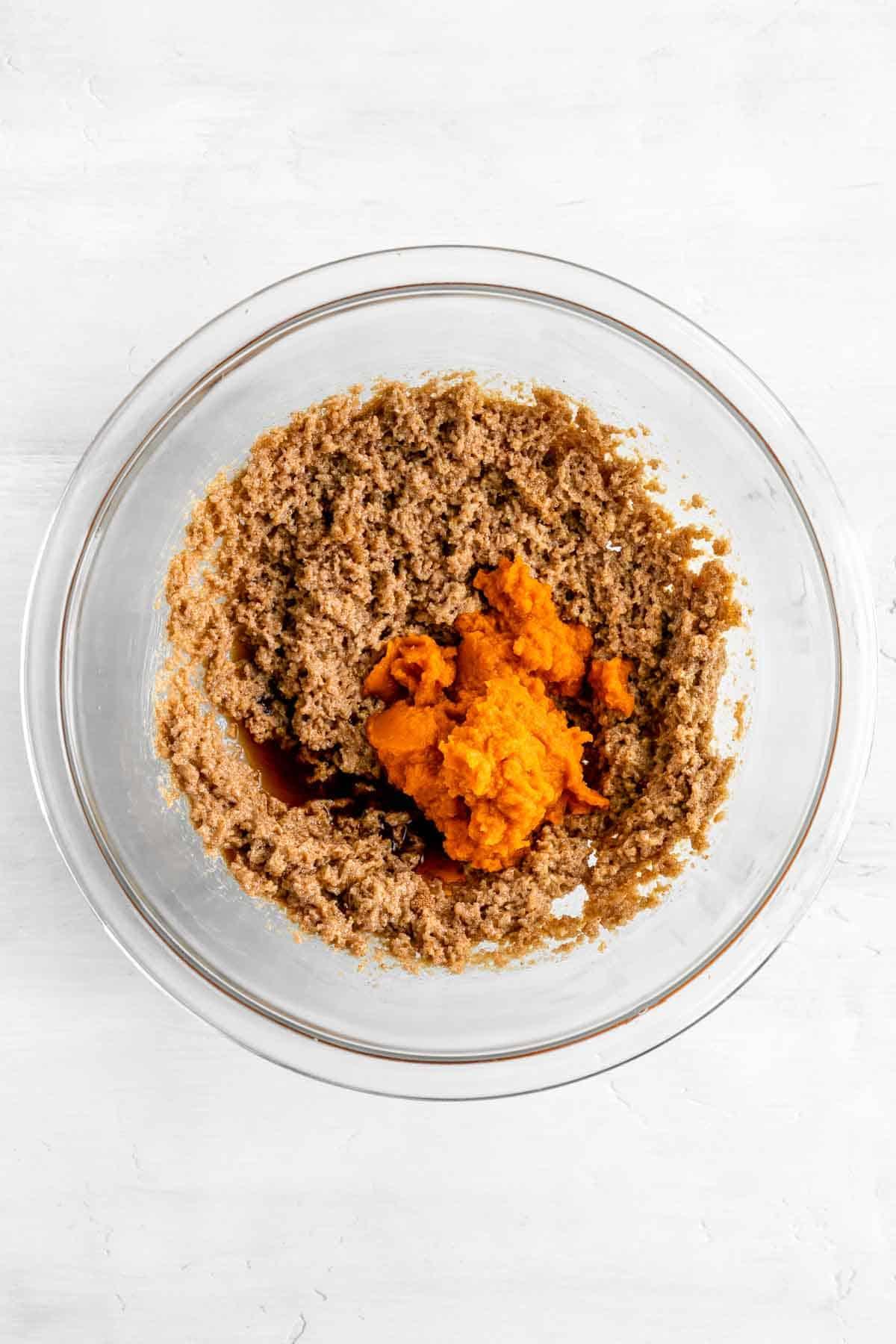 pumpkin puree, brown sugar, white sugar, and vegan butter in a glass bowl