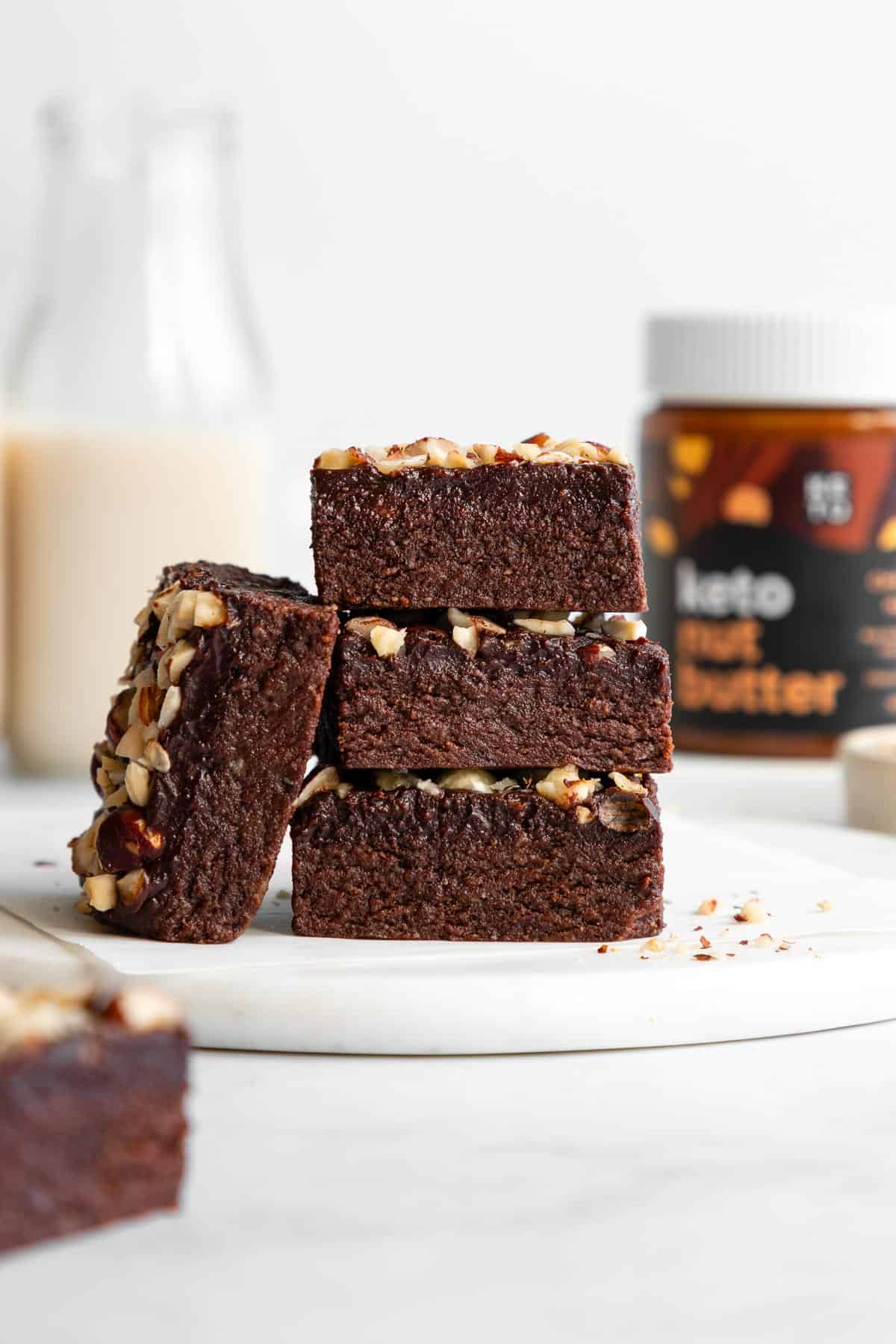 a stack of three keto hazelnut brownies