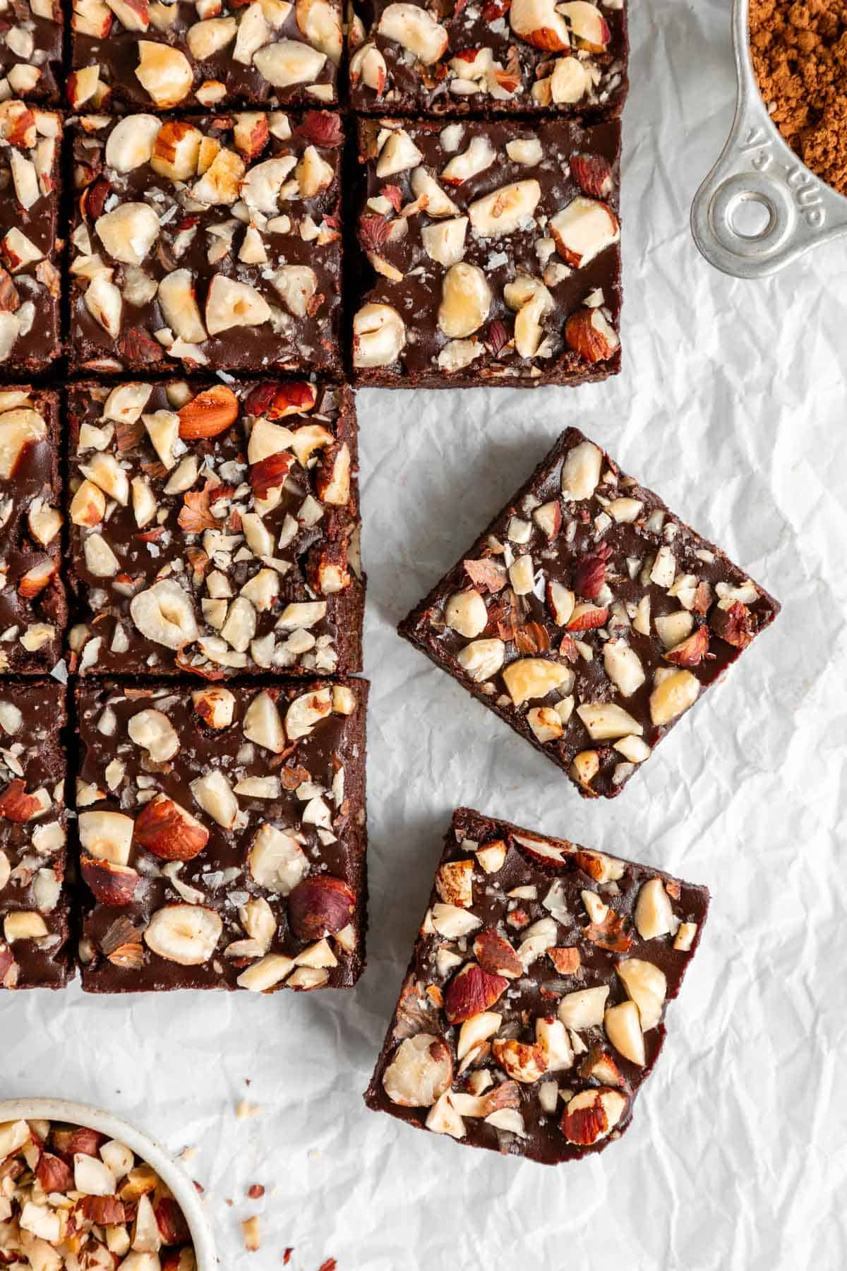 no-bake hazelnut brownies sliced on white parchment paper