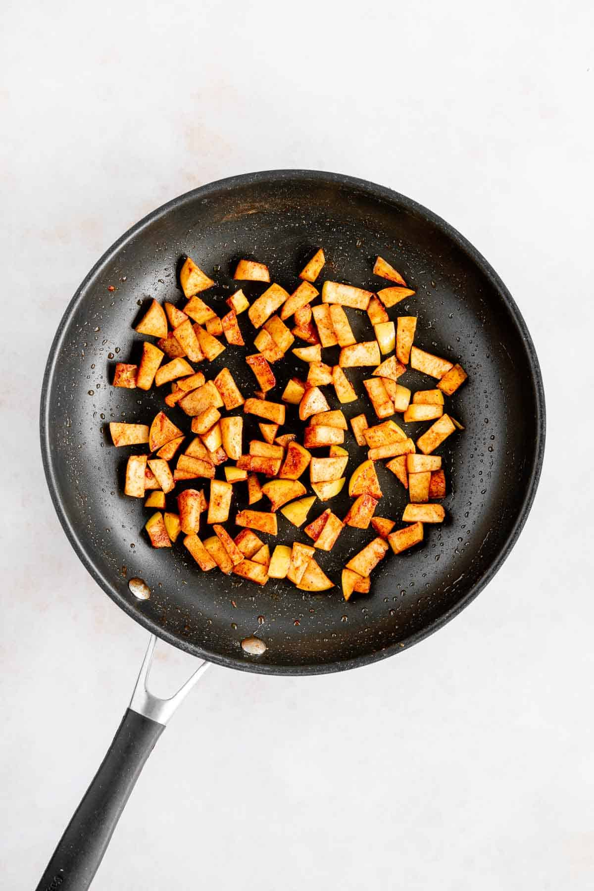 caramelized apples with cinnamon on a skillet
